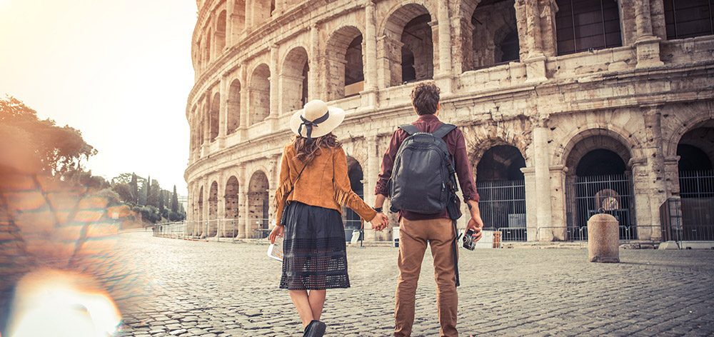 Couple standing at the Colosseum
