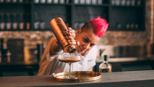 Chef Anna Polyviou mixing up an espresso martini with Tanglin Honey Bean Gin Liqueur. Supplied.