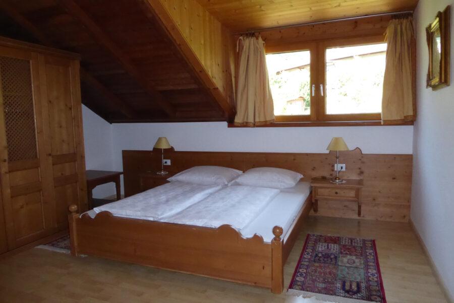 Apartment Mendel Schlafzimmer mit Dachgaube