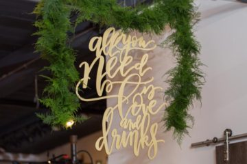 Lasercut signage hung from the ceiling and framed by greenery to celebrate Pantone's 2017 Color of the Year!