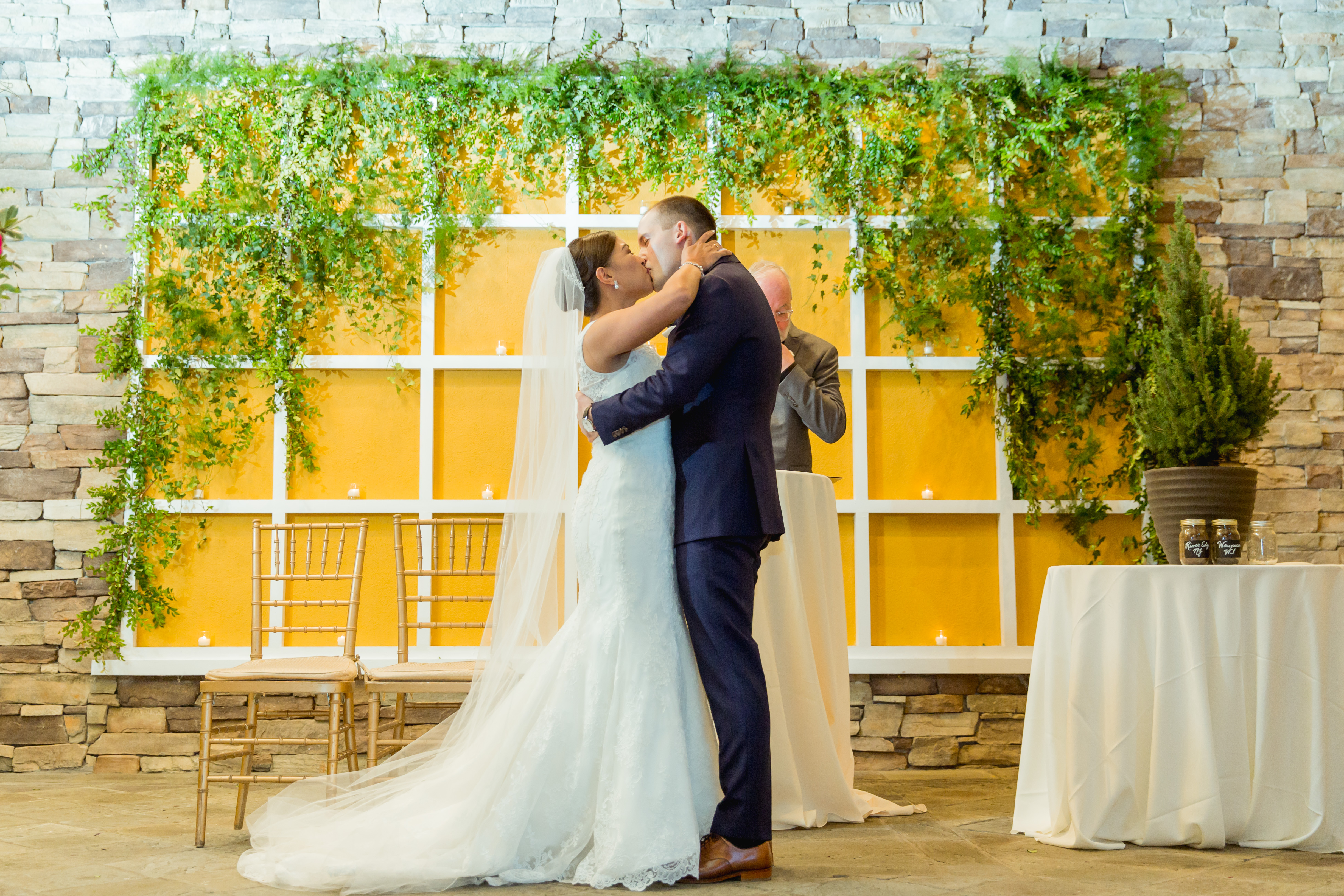 Gorgeous greenery backdrop inspiration for a wedding ceremony!