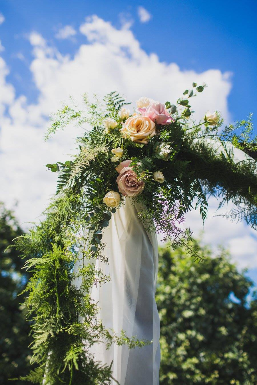 This garden ceremony was super chic with an arbor draped in white, greenery and plenty of pink roses. We have more garden wedding inspiration up on the blog right now!