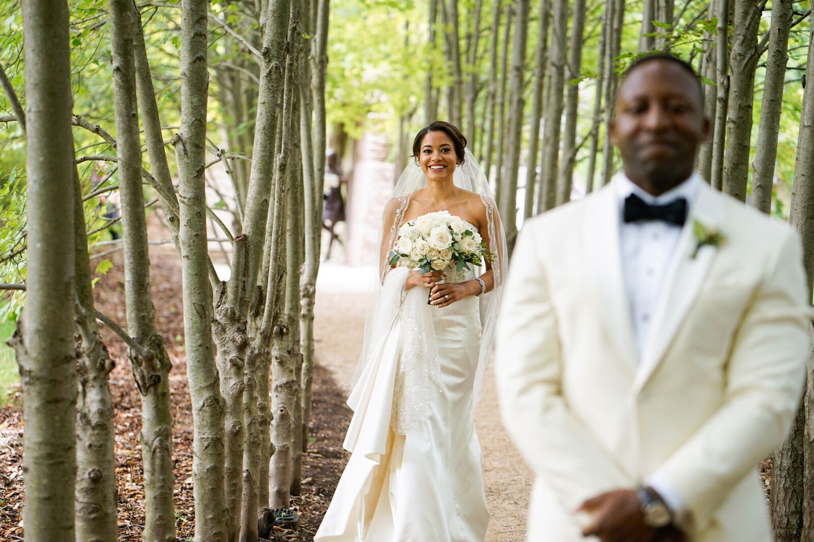 The first look at a wedding has to be perfectly timed and in a great location. Check out this garden wedding we planned and how we kept the public from photobombing this romantic moment!