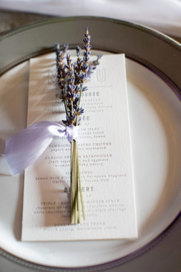 Lavender sprig at a wedding place setting