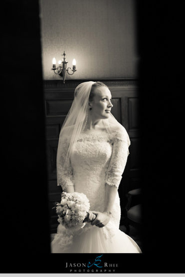Bride in long sleeve lace gown