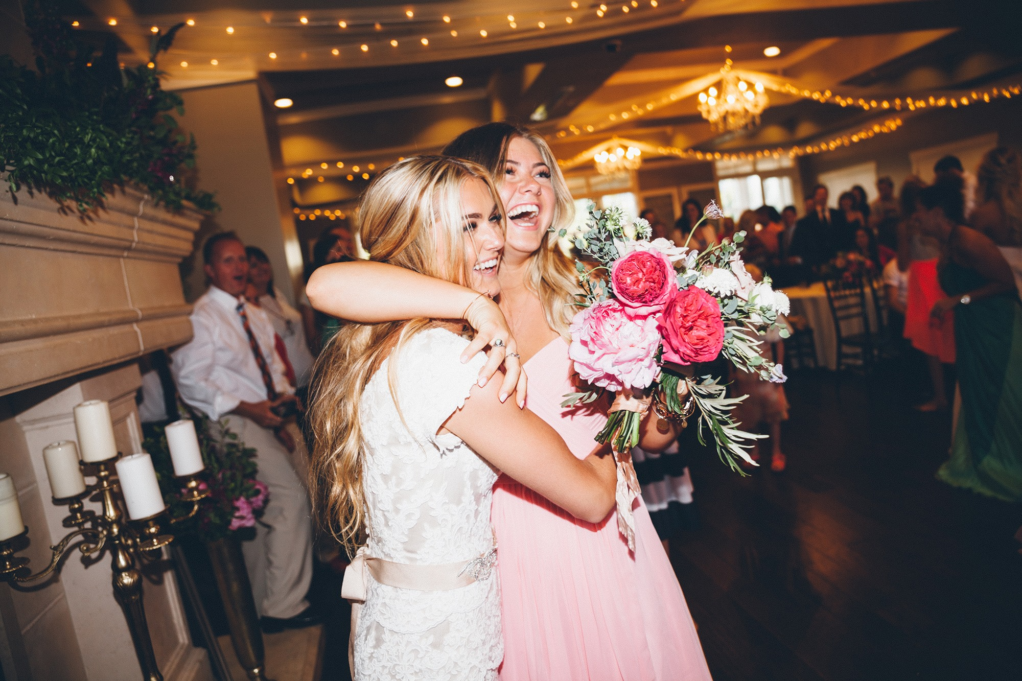 bride and maid of honor with flowers