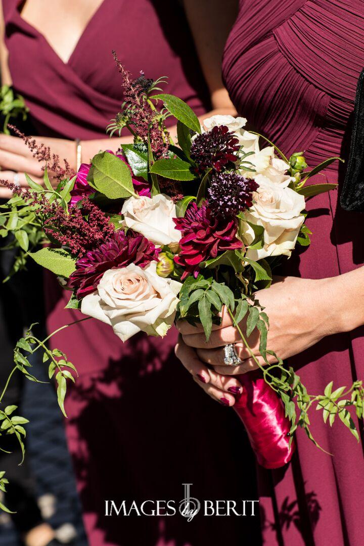 bridesmaids bouquets in deep colors