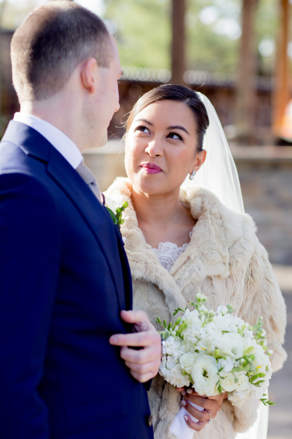 bride with fur stole over wedding gown