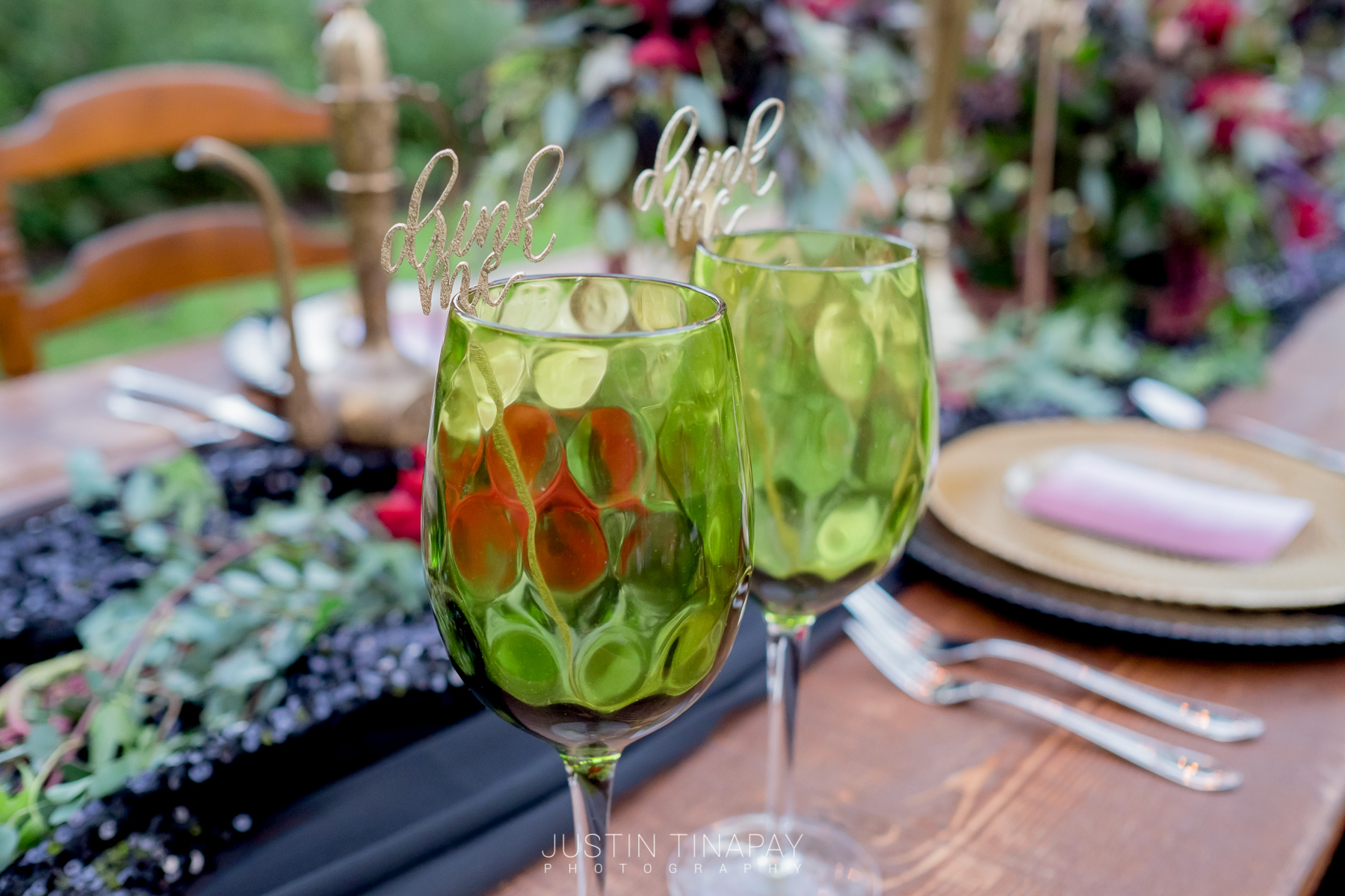 green wine glasses with laser cut drink stirrers