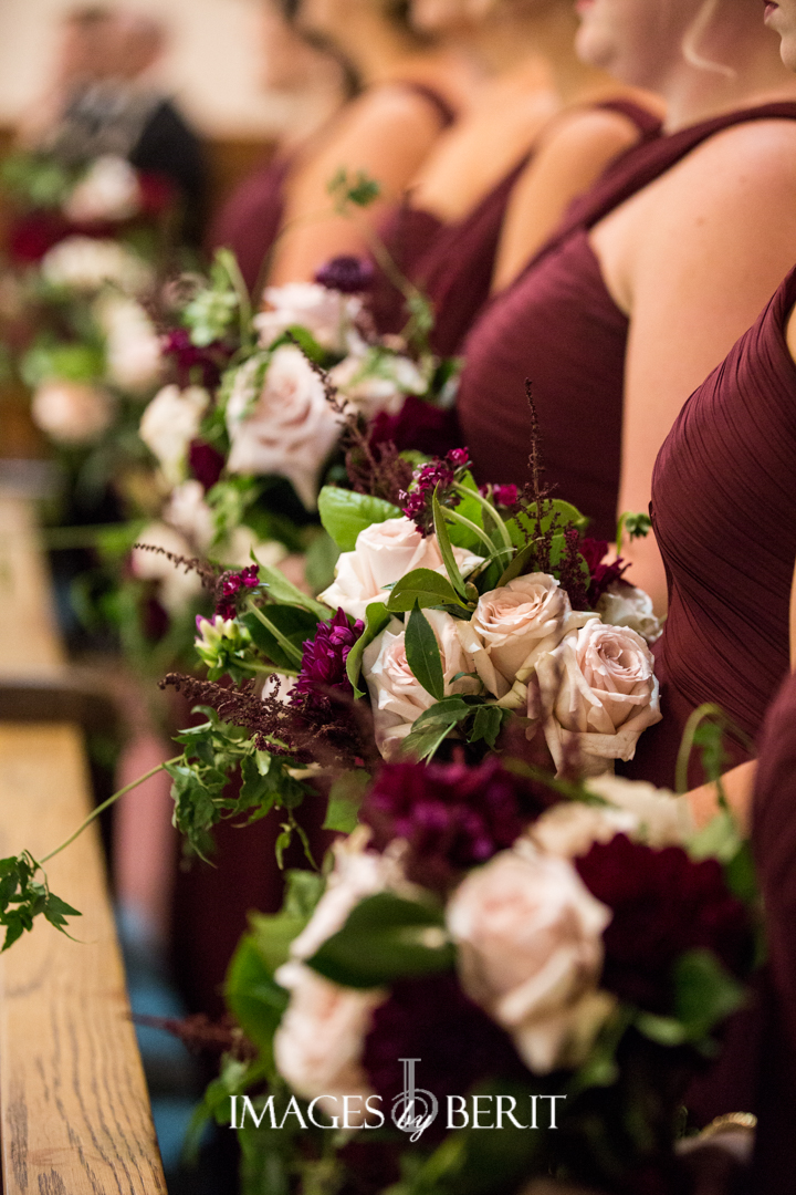 bridesmaid bouquets in blush and wine with greenery