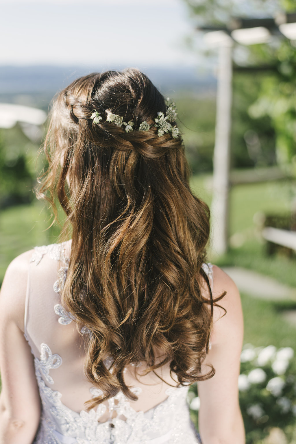 back of bride's hair with floral crown