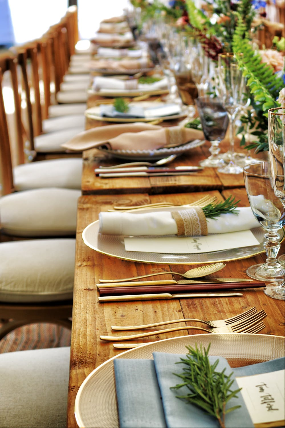 long wood table with evergreen touches