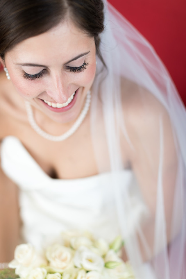 smiling bride in dress and veil