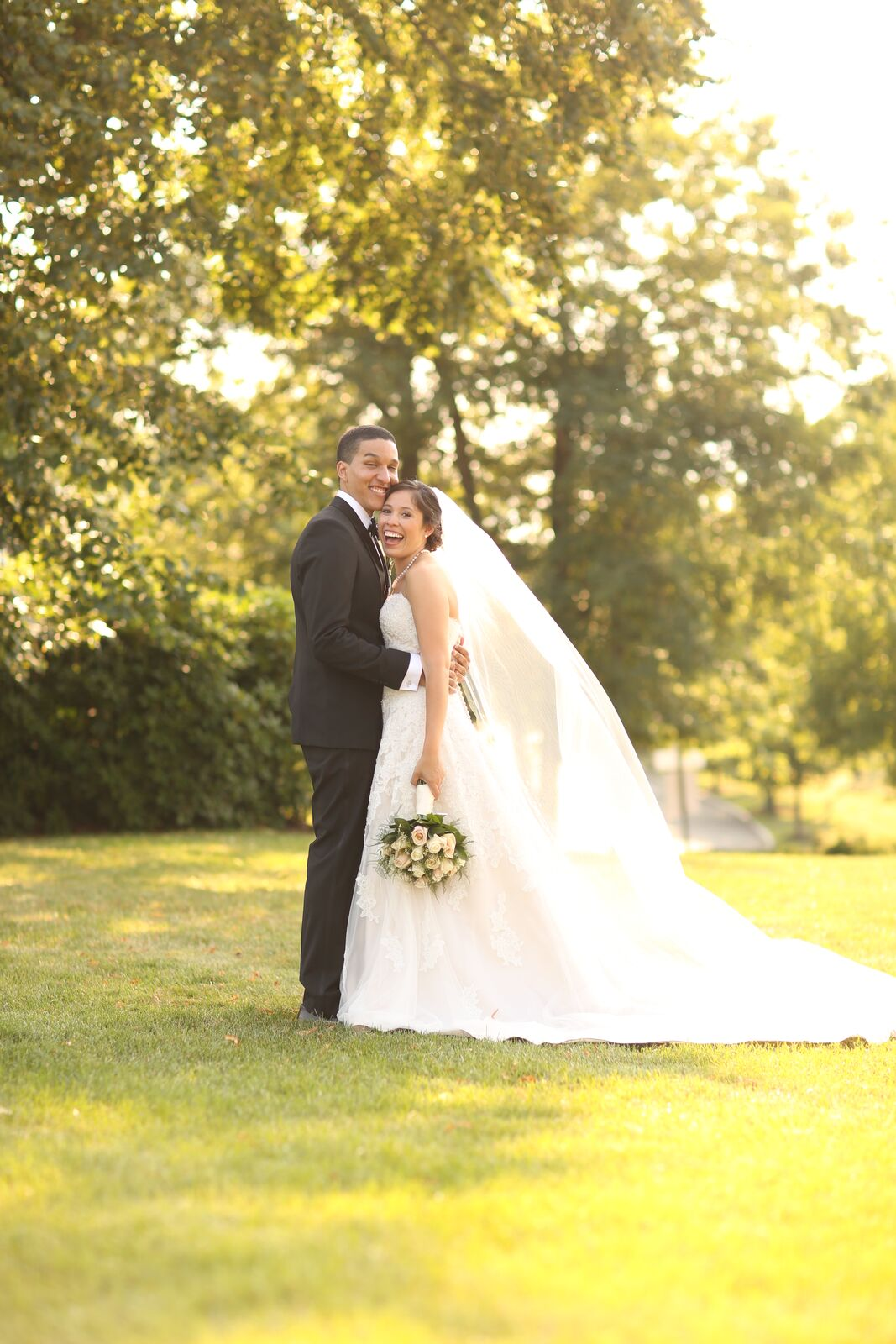 bride and groom outside in sunshine