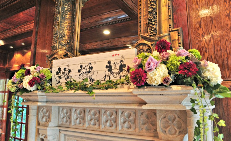flowers and disney characters on mantle at wedding