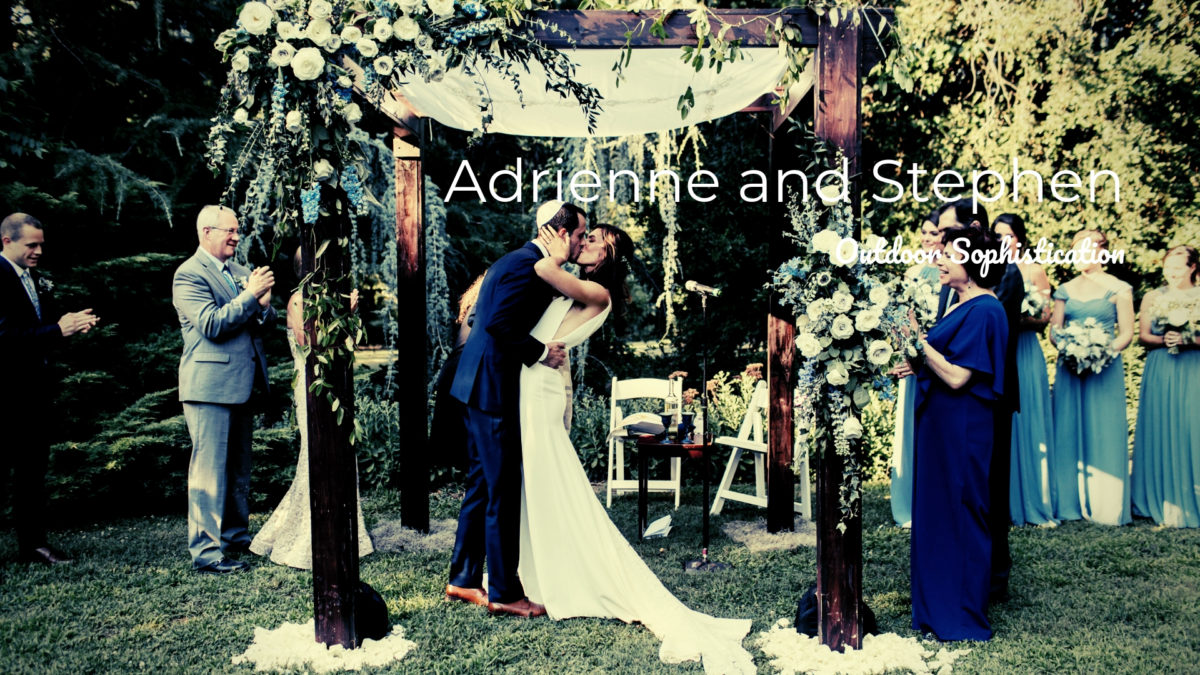 bride and groom kissing under chuppah at wedding ceremony