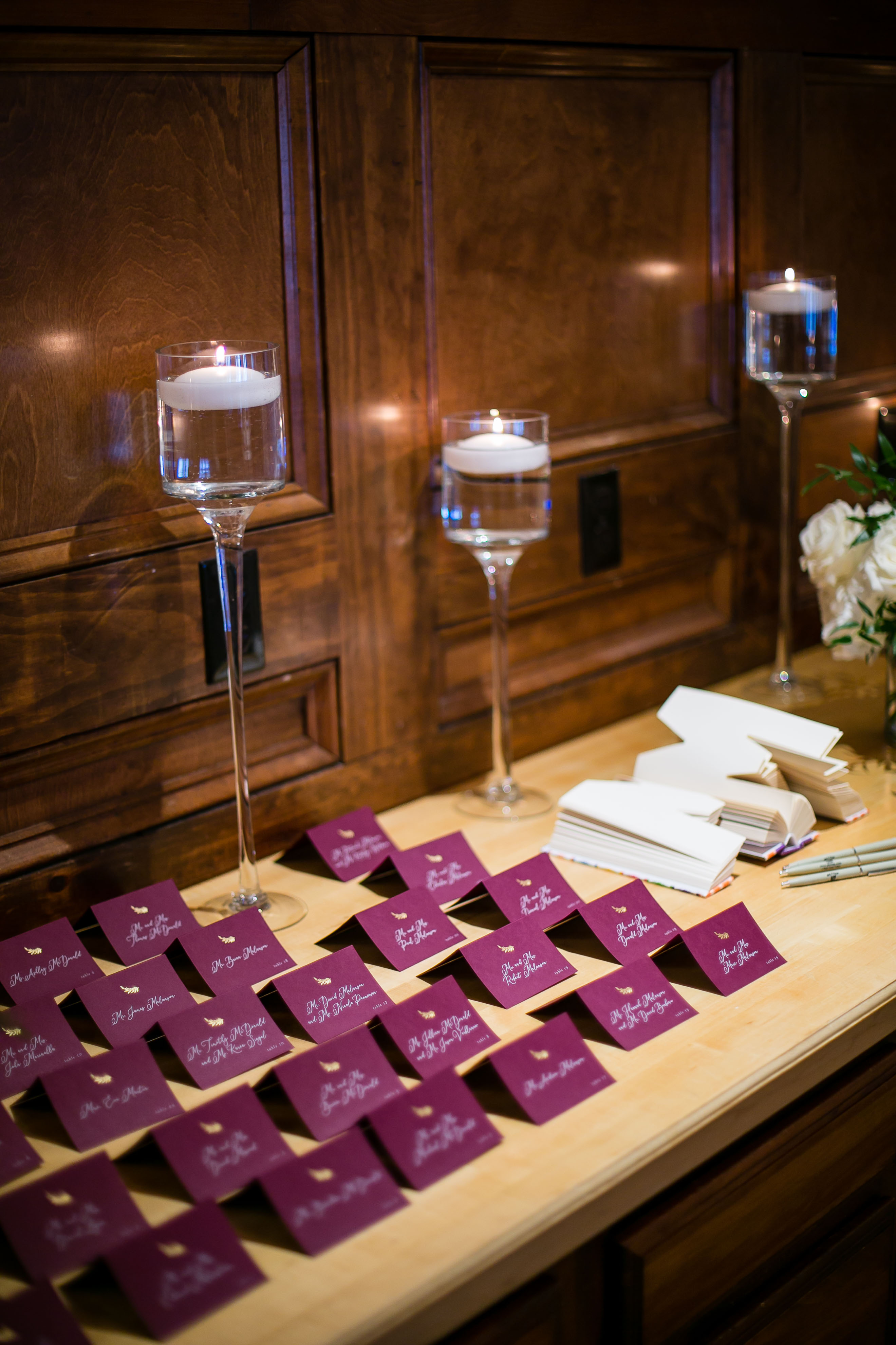 maroon escort cards and candles