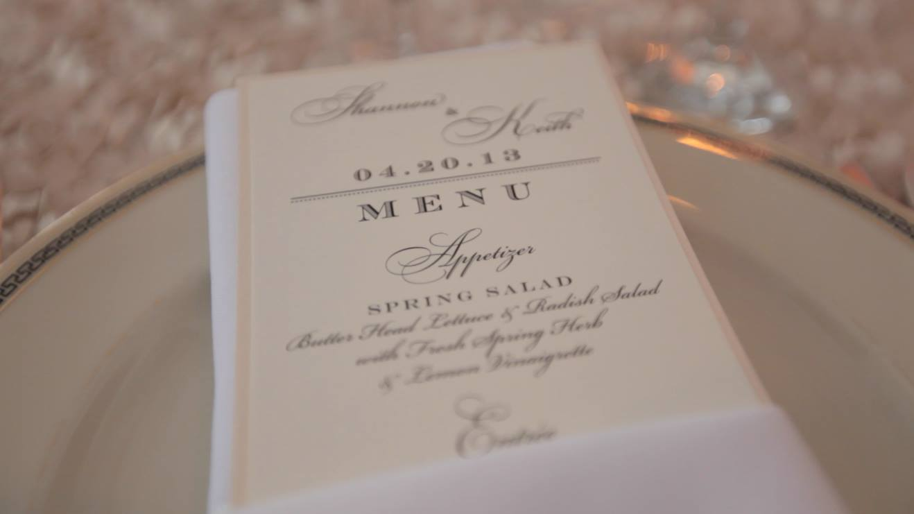 gold rimmed plate with menu and napkin