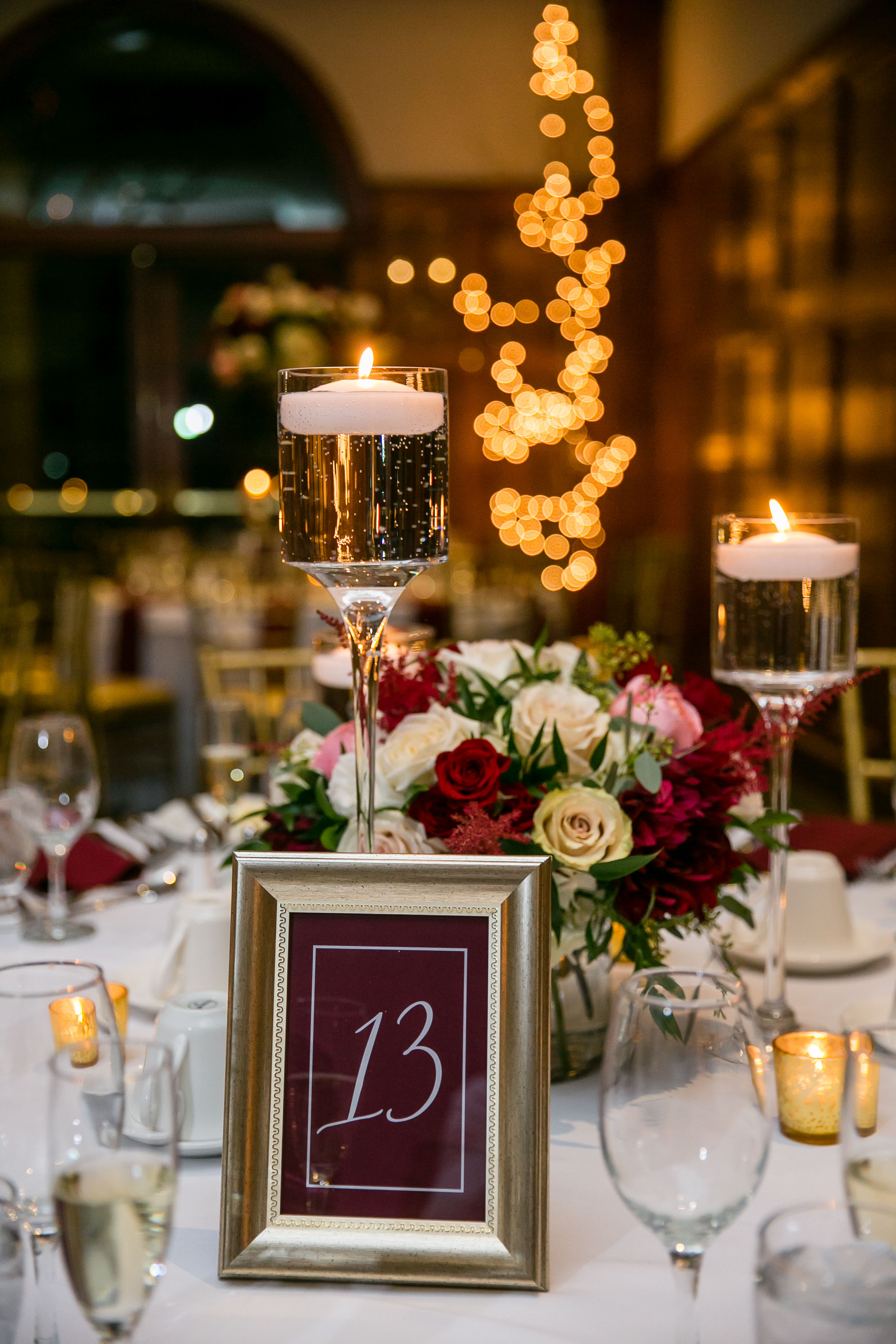 wine marsala reception table with candles