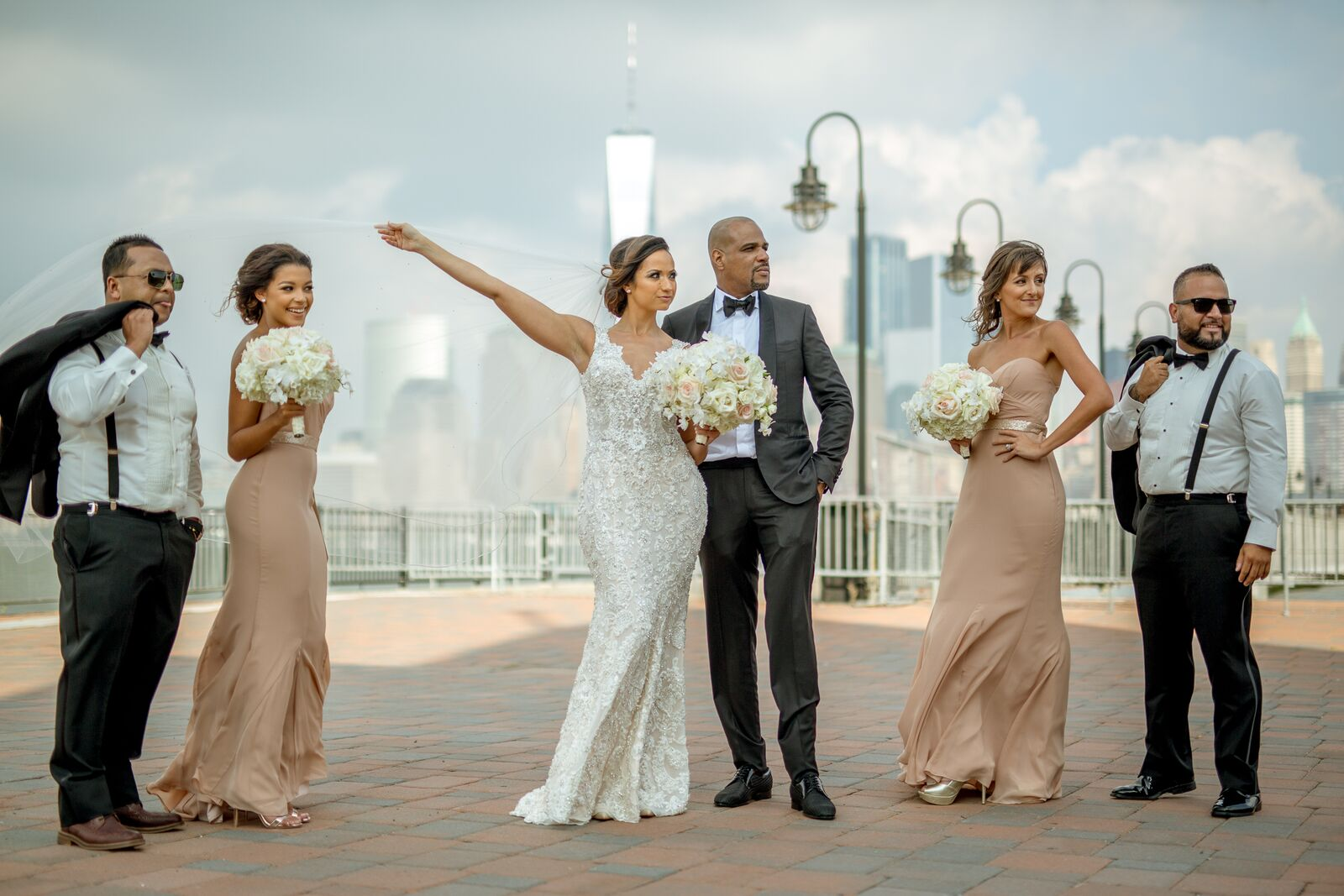 bride and groom with bridesmaids in champagne