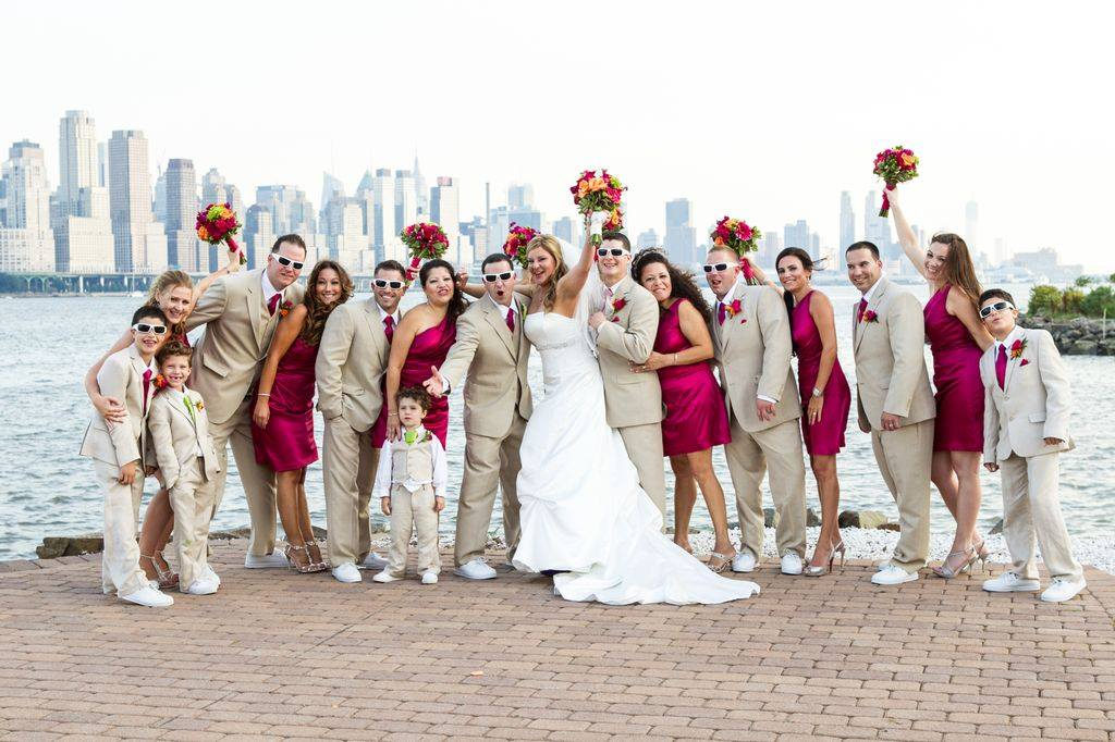 bridesmaids in short hot pink dresses and groomsmen in khaki suits