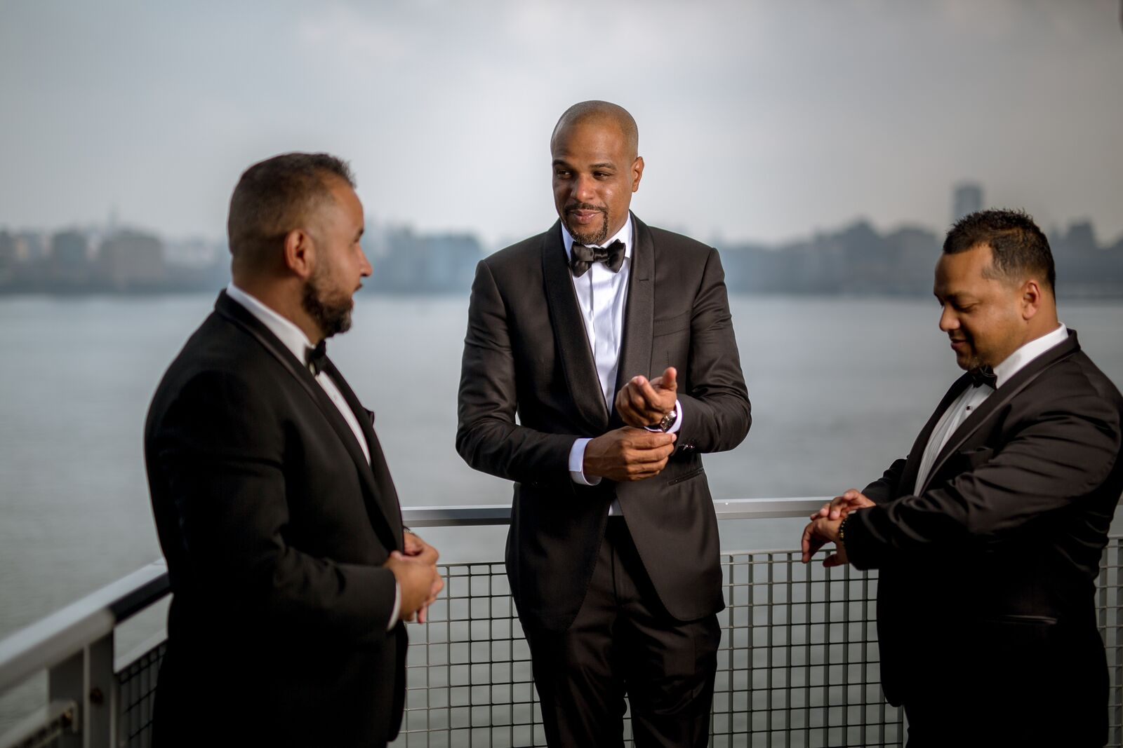 groom and groomsmen in black tuxedos
