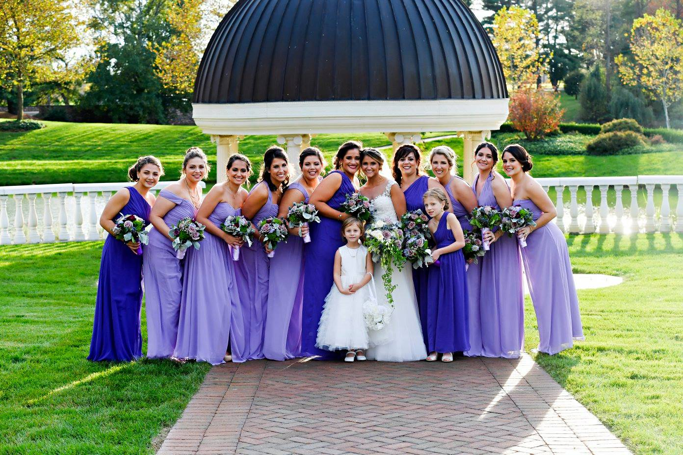 bridesmaids in two shades of long purple gowns