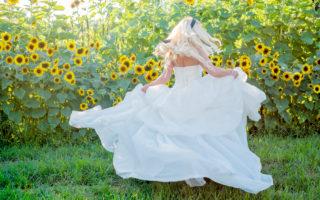 bride twirling in ballgown