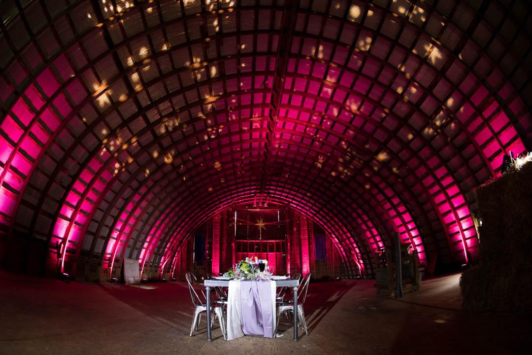 barn wedding with pink lighting