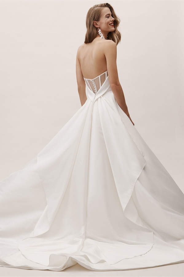bride with low back wedding gown on