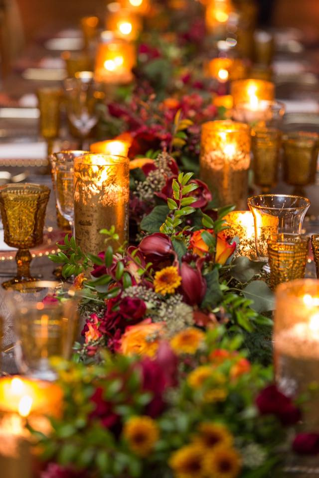 floral runner with candles down long table