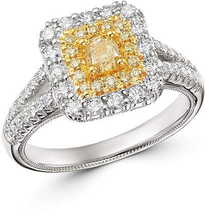 halo engagement ring with yellow center stone