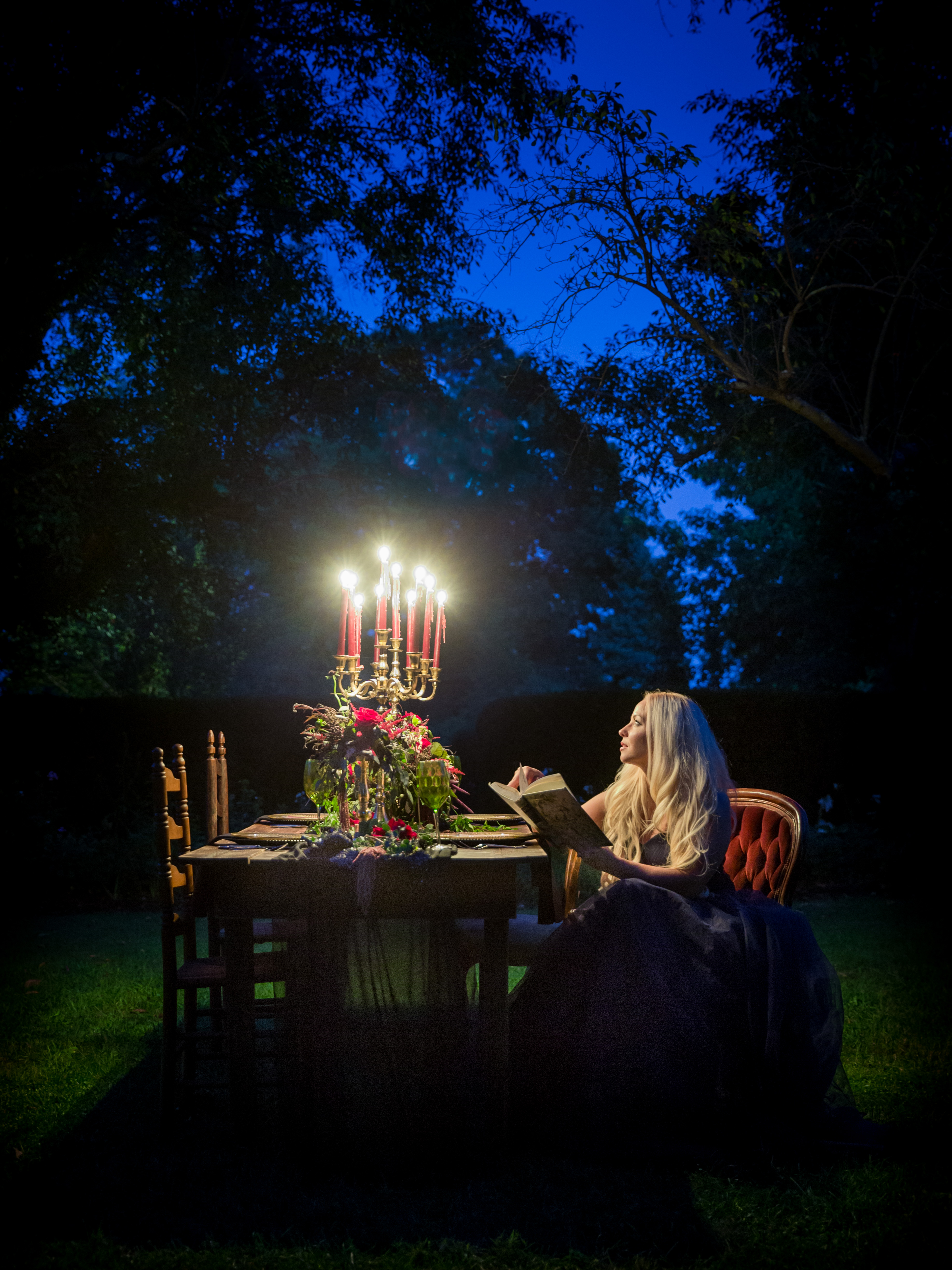 outside picture at night with bride at table