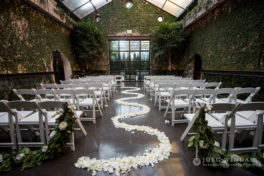 ceremony aisle with white rose petals