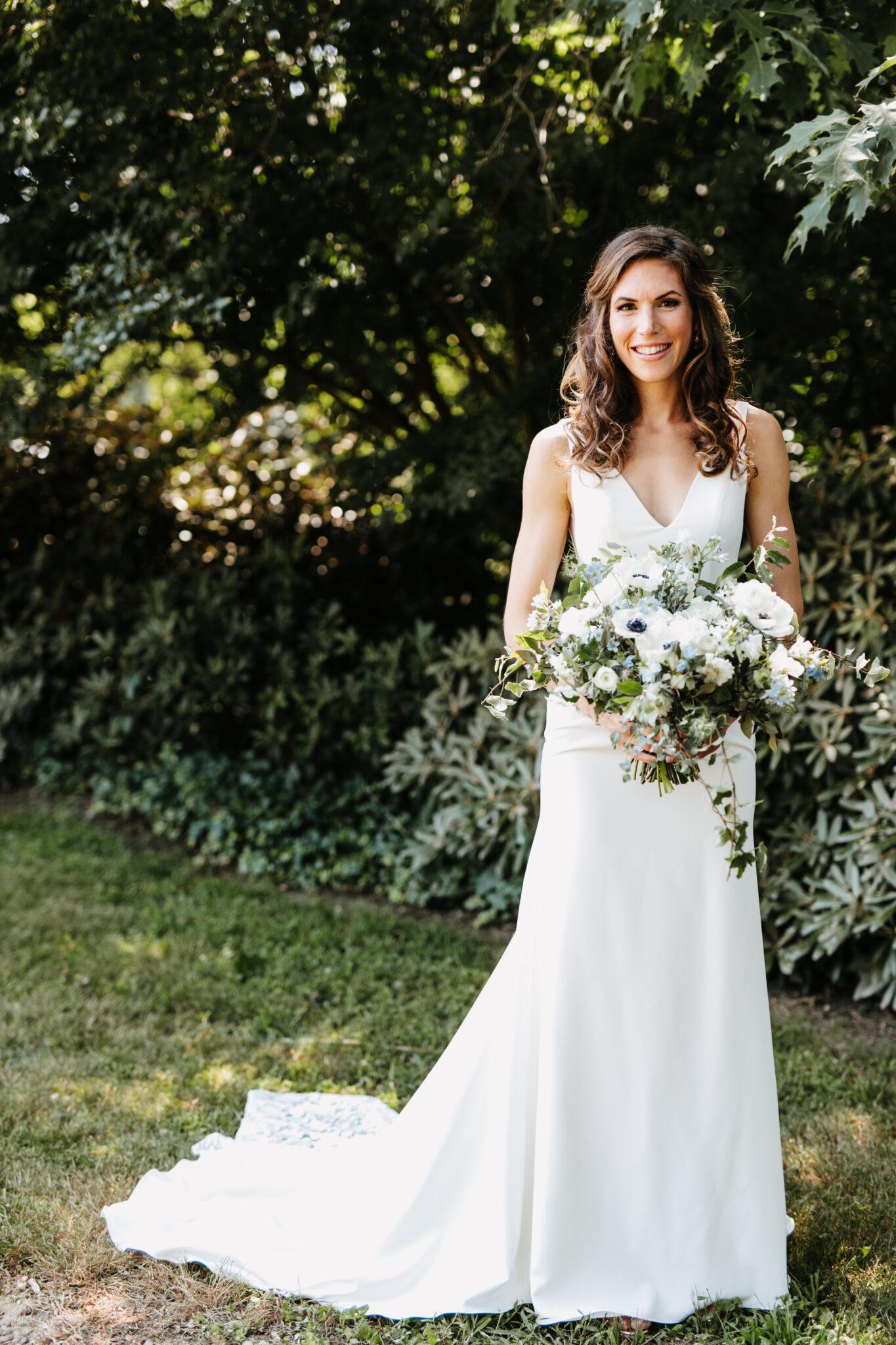 bride holding bouquet outdoors