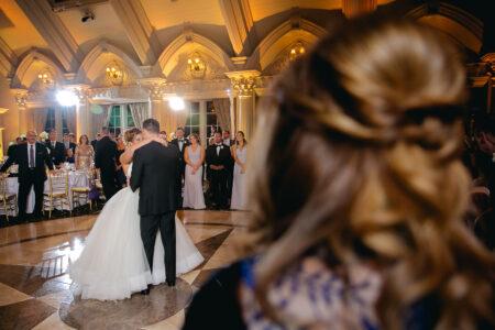 bride and groom dancing first dance in ballroom