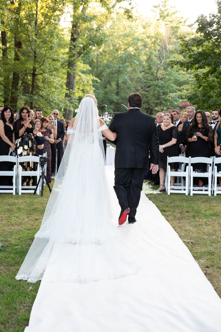 father walking daughter down the aisle at wedding