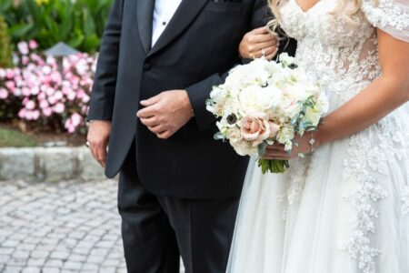 father of the bride and bride arm in arm