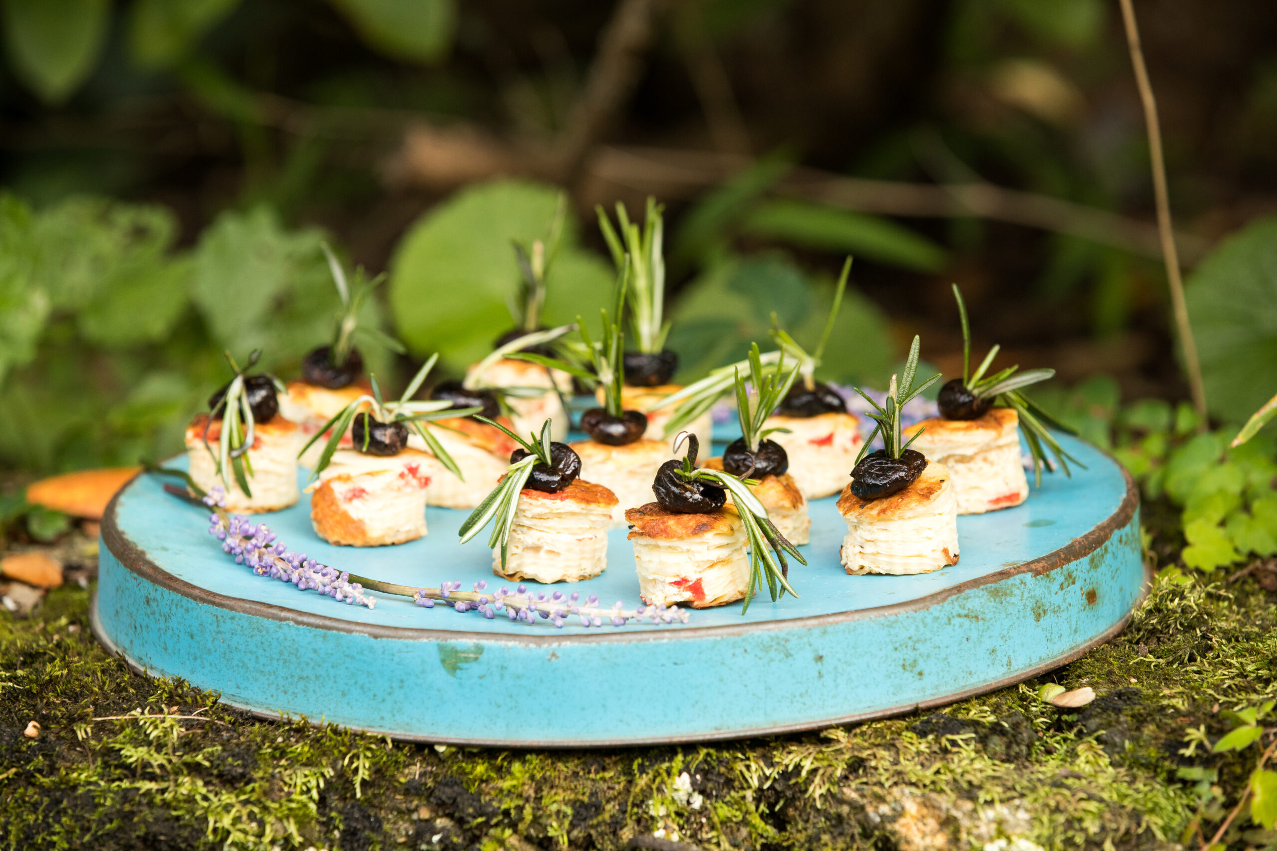 appetizers being passed at a wedding blue tray