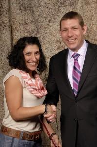 Carmela Bishop receives award from CRST STI President Andrew Hadland.