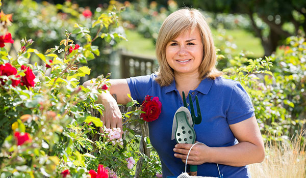 woman-in-the-garden-helps prevent leaks and wasted water.