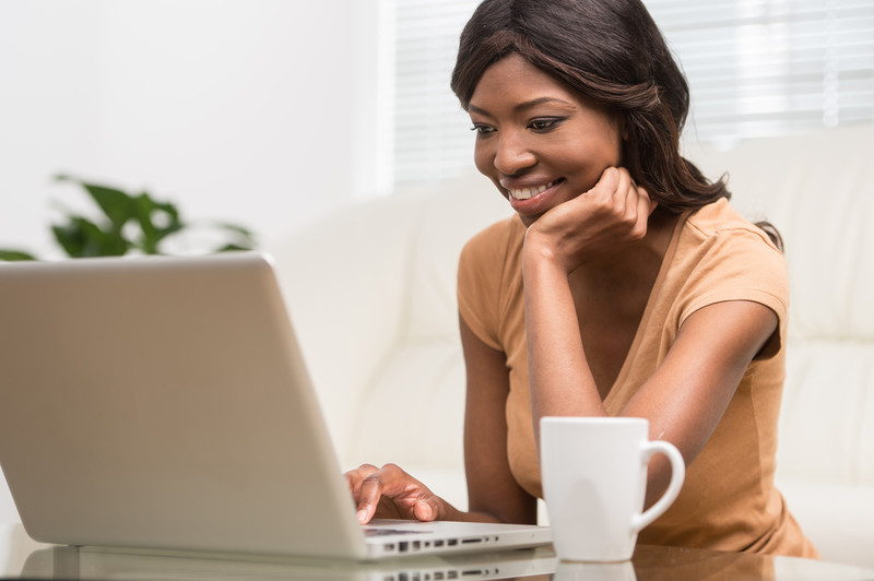 woman looking at her laptop screen