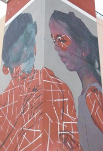The mural by Evoca1 in its early stages on the Southwest Parking Garage.