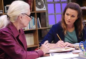 Lisa Morrison listens intently to her writing mentor, Ruth Steiner