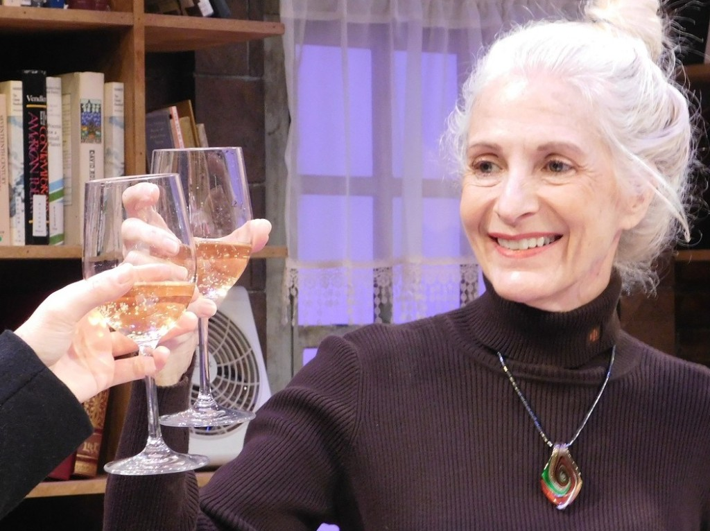Sara Morsey, as Ruth, offers a toast during Collected Stories.