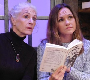 Ruth and Lisa examine a book by Delmore Schwartz.