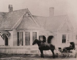Dr. Sarah Robb in a horse-drawn buggy outside her house, which still stands on Southwest 2nd Avenue.