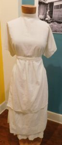 A midwife's uniform from the early 20th century.
