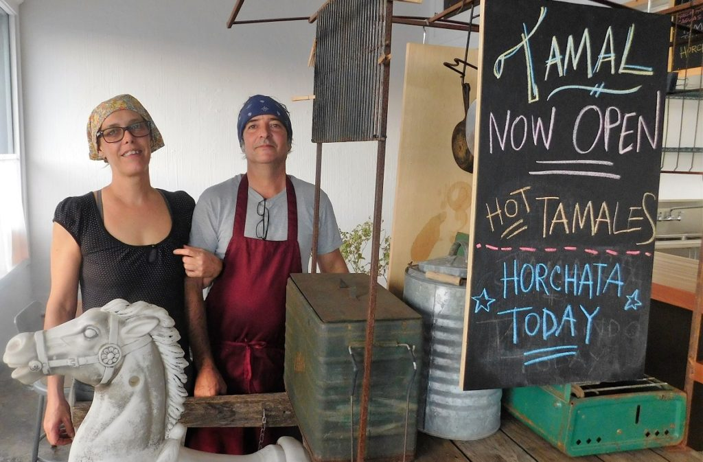 Rachel and Nicholas Iannelli in front of their former food cart at Tamal. Photo by Gainesville Downtown)