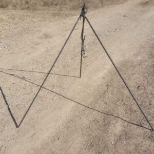 Handmade steel campfire tripod with S hooks for holding pots over an open fire